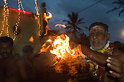 Sri Lanka. Udappuwa. On the dawn of the day of the fire walking, the chief priest, Manivasa Gurukal brings out from the Hindu Temple a pot of 'Sacred Fire' that will kindle the wood pyre.