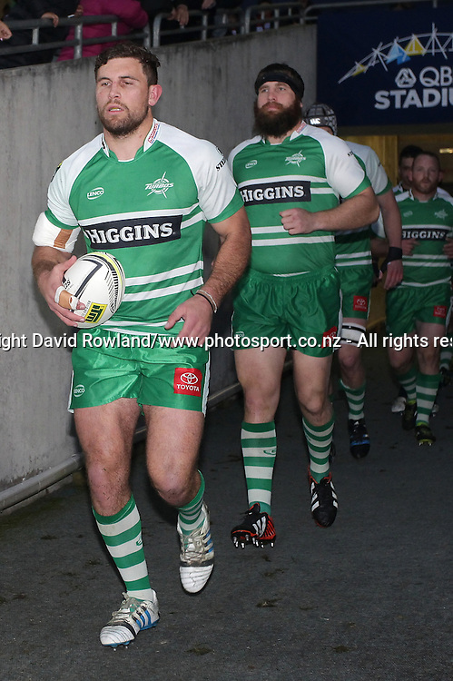 Manawatu`s captain Callum Gibbins leads his team out for an ITM Cup Rugby Match, North Harbour v Manawatu, QBE Stadium, Auckland, New Zealand, Friday, September 12, 2014. Photo: David Rowland/Photosport