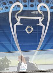 May 13, 2018 - Kiev, Ukraine - A couple walk near NSC Olimpiyskiy covered with banners for the Champions League in Kyiv, Ukraine, May 13, 2018. Kyiv prepares to host UEFA Women's Champions League final between Wolfsburg and Lyon at Valeriy Lobanovskiy Dynamo Stadium on 24 May, 2018 and the UEFA Champions League final match between Real Madrid and  Liverpool at NSC Olimpiyskiy Stadium on Saturday 26 May, 2018. (Credit Image: © Sergii Kharchenko/NurPhoto via ZUMA Press)
