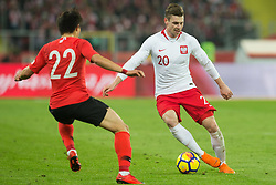 March 27, 2018 - Chorzow, Poland - Chang-hoon Kwon (KOR) vies Lukasz Piszczek of Poland during the international friendly soccer match between Poland and South Korea national football teams, at the Silesian Stadium in Chorzow, Poland on 27 March 2018. (Credit Image: © Foto Olimpik/NurPhoto via ZUMA Press)