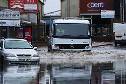 © Licensed to London News Pictures. 22/11/2016. Rotherham, UK. A truck drives through a flooded road in Rotherham, South Yorkshire, after a river broke it's banks last night. Storm Angus has brought heavy wind and rain to much of the UK this week with flooding seen all over. Photo credit : Ian Hinchliffe/LNP