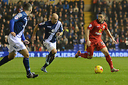 Blackburn Rovers midfielder Craig Conway on the ball watched by Birmingham City midfielder David Cotterill during the Sky Bet Championship match between Birmingham City and Blackburn Rovers at St Andrews, Birmingham, England on 3 November 2015. Photo by Alan Franklin.