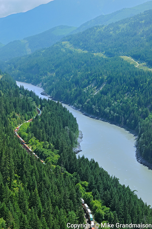 Train running along the Fraser River in the Fraser Canyon, Near Boston Bar, British Columbia, Canada
