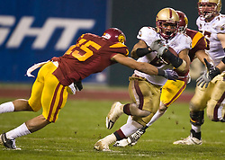 Dec 26, 2009; San Francisco, CA, USA;  Boston College Eagles running back Montel Harris (2) breaks a tackle from Southern California Trojans cornerback Kevin Thomas (15) during the second quarter of the 2009 Emerald Bowl at AT&T Park.  USC defeated BC 24-13.