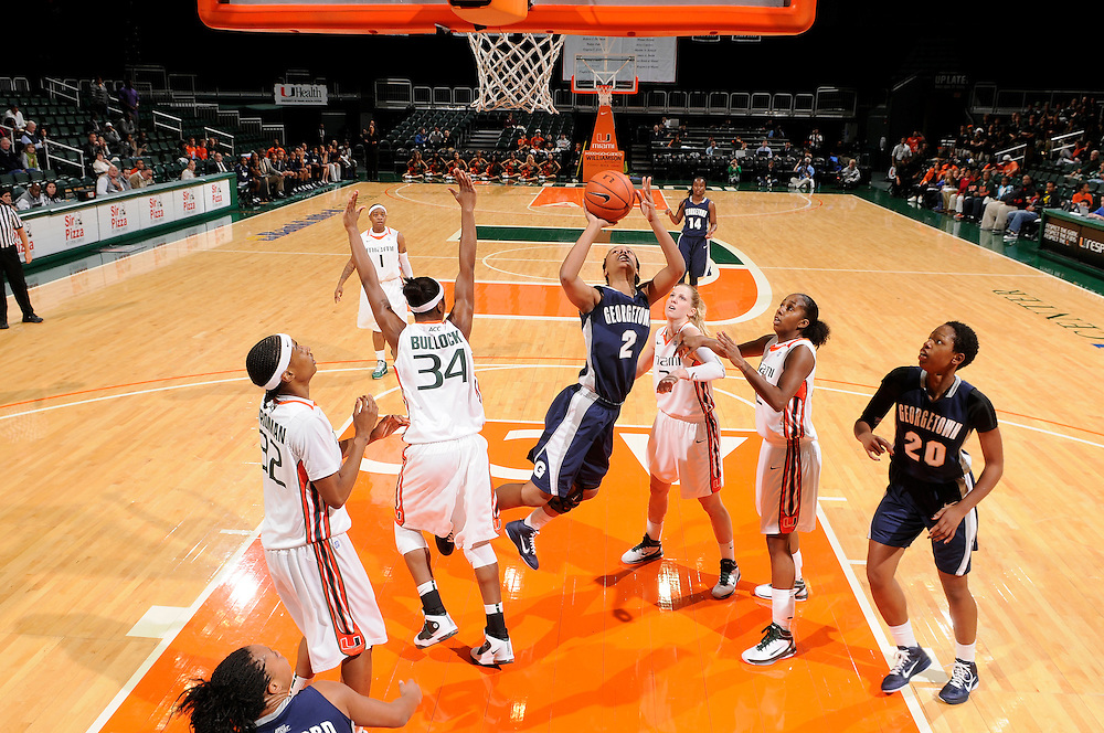 December 7, 2010: Tia Mcgee of the Georgetown Hoyas shoots past Morgan Stroman (32), Sylvia Bullock (34), Shenise Johnson (42) and Stefanie Yderstrom (3) of the Miami Hurricanes during the NCAA basketball game between Georgetown and Miami. The 'Canes defeated the Hoyas 81-72.