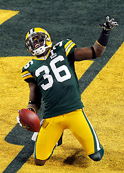 Feb 6, 2011; Arlington, TX, USA; Green Bay Packers safety Nick Collins (36) celebrates after returning an interception for a touchdown during the first half of Super Bowl XLV against the Pittsburgh Steelers at Cowboys Stadium.  Green Bay defeated Pittsburgh 31-25.
