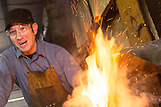 Blacksmith Frank Verga working at a forge in an iron working shop in Charleston, SC