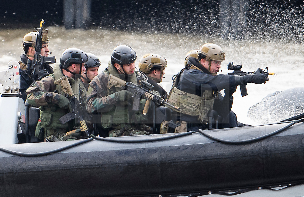 © Licensed to London News Pictures. 24/10/2018. London, UK. British Royal Marines are joined by the The Royal Netherlands Marines in a military demonstration at HNLMS Zeeland, which is anchored next to anchored next to HMS Belfast on the River Thames in central London. Members of the British and Dutch Royal families watched the event as part of a state visit to the UK. Photo credit: Ben Cawthra/LNP