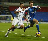 Photo: Aidan Ellis.<br /> Bolton Wanderers v Wigan Athletic. The Barclays Premiership. 04/11/2006.<br /> Bolton's Tal Ben Haim (L) and Wigan's Kevin Kilbane