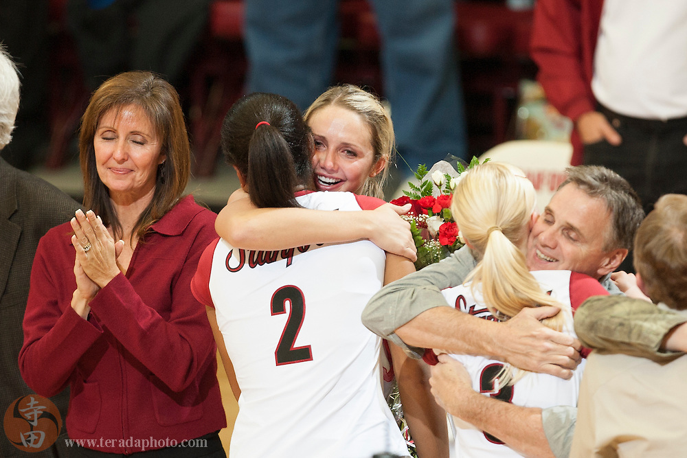 November 25, 2006; Stanford, CA, USA; Stanford Cardinal outside hitter Kristin Richards (10) hugs middle blocker Janet Okogbaa (2) during senior night before the game against the Washington State Cougars at Maples Pavilion. The Cardinal defeated the Cougars 30-27, 30-23, 30-18.