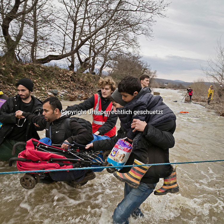 Greece, Idomeni, Refugees on their way to Europe,   March of Hope<br /> <br /> Refugees from Syria, Irak, Afghanistan and others from the near east are trying to reach the border between Greece and Macedonia (FYROM), they had to cross the small river Suva Reka, near the village Hamilo.<br /> Volunteers set up a rope and assist the refugees to cross the river.<br /> <br /> Nadeloehr nach Nordeuropa Idomeni, der Grenzuebergang ist seit Tagen gesperrt,. <br /> Es ensteht im provisorischen Fluechtlingslager in Idomeni eine ngespannte Lage. <br /> Regen und Kaelte machen vor allem den Familien mit kleinen Kindern zu schaffen. <br /> <br /> Idomeni, is the eye of a needle for getting to nothern Europe. <br /> The FYRO macedonian authorities, closed the border from Greece completely. The situation close to the border gets more and more difficult. The People have to sleep outside or in small tents. <br /> Heavy rainfalls and cold nights are treating the refugees badly. Some already stayed up to ten nights at Idomeni. There is not enough food and supplies to help about 14.000 refugees<br /> <br /> <br /> keine Veroeffentlichung unter 50 Euro*** Bitte auf moegliche weitere Vermerke achten***Maximale Online-Nutzungsdauer: 12 Monate !! <br /> <br /> for international use:<br /> Murat Tueremis<br /> C O M M E R Z  B A N K   A G , C o l o g n e ,  G e r m a n y<br /> IBAN: DE 04 370 800 40 033 99 679 00<br /> SWIFT-BIC: COBADEFFXXX