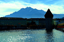 The Chapel Bridge (Kapellbrücke)with Mount Pilatus in the background.