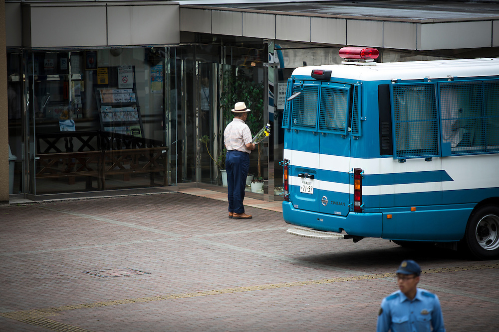 SAGAMIHARA, JAPAN - JULY 27 :  A relative visit to offer a flower for the victim in front of the entrance of Tsukui Yamayuri-en building at Sagamihara on Wednesday, July 27, 2016 in Kanagawa prefecture, Japan. Police arrested 26 year old Satoshi Uematsu after breaking inside the building facility for handicapped and killing 19 people and injuring 20 in the city of Sagamihara, west of Tokyo. (Photo: Richard Atrero de Guzman/NURPhoto)