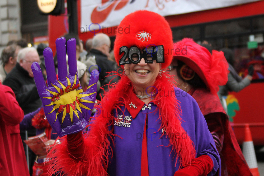 The Red Hat Society London's New Year's Day Parade, City of Westminster, London, UK, 01 January 2011:  Contact: Ian@Piqtured.com +44(0)791 626 2580 (Picture by Richard Goldschmidt)