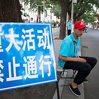 BEIJING, SEPT.9,2015 : &quot;volunteers&quot; show p in the late afternoon of Sept. 2 to make sure the  sidewalks and streets are gradually emptied for the celebrations to  commemorate the 70th anniversary of the end of World War II.<br /> The note in Chinese translates as &quot; big event, forbidden to pass &quot;