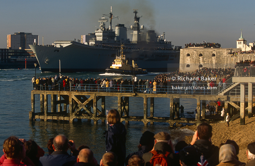 Seen off by thousands of the patriotic public, the Royal Navy's HMS Ark Royal aircraft carrier leaves Portsmouth docks for active service off Iraq, on 11th January 2003, in Portsmouth, Hampshire, England.