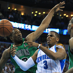 11 February 2009: New Orleans Hornets guard Chris Paul (3) is defended by Boston Celtics forward Leon Powe (0) during a 89-77 loss by the New Orleans Hornets to the Boston Celtics at the New Orleans Arena in New Orleans, LA.