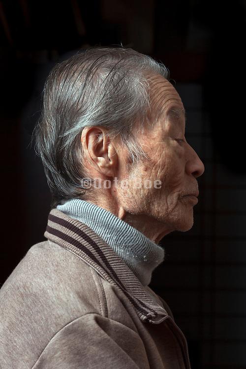 side view portrait of elderly Japanese man