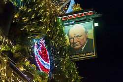 © Licensed to London News Pictures. 07/12/2018. LONDON, UK.  The annual Christmas lights of The Churchill Arms pub in Kensington have been switched on for the season.  A total of 97 Christmas trees (93 outside and 4 inside) together with 21,500 lights comprise the festive decorations.  Photo credit: Stephen Chung/LNP