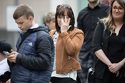 © Licensed to London News Pictures . 30/06/2017 . Stockport , UK . Mourners wait outside the Town Hall ahead of the service . The funeral of Martyn Hett at Stockport Town Hall . Martyn Hett was 29 years old when he was one of 22 people killed on 22 May 2017 in a murderous terrorist bombing committed by Salman Abedi, after an Ariana Grande concert at the Manchester Arena . Photo credit : Joel Goodman/LNP
