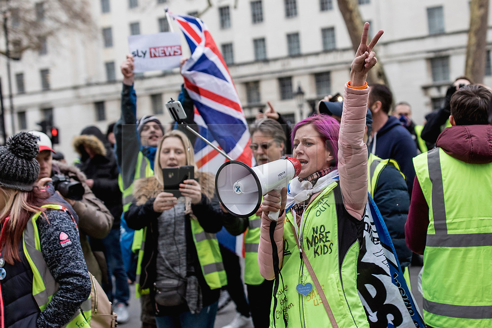 """© Licensed to London News Pictures. 12/01/2019. London, UK. A pro-Brexit """"yellow vest"""" protester outside Downing Street. James Goddard, who was involved in an incident with Conservative MP Anna Soubry, was arrested by police this morning. Photo credit: Rob Pinney/LNP"""
