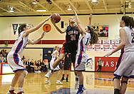 Washington Warrior's Dani Franklin (32) and Washington Warrior's Devin Glenski (14) try to block a shot by Linn-Mar Lion's Courtney Major (34) during their Regional Semi-Final game at Washington High School in Cedar Rapids on Saturday, February 16 2013.
