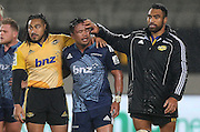 Hurricanes  Ma`a Nonu, left, Blues Keven Mealamu and Hurricanes  Victor Vito after the Super Rugby Match, Blues v Hurricanes, Eden Park, Auckland, New Zealand, Saturday, May 23, 2015. Copyright photo: David Rowland / www.photosport.co.nz