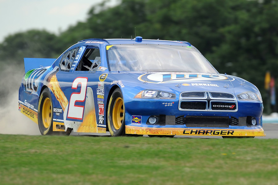 Brad Keselowski, driver of the (2) Miller Lite Dodge, kick up a little dust while exiting the inner loop during practice for the Heluva Good! Sour Cream Dips at The Glen in Watkins Glen, NY. Marcos Ambrose posted the fastest practice speed of the day with a speed of 126.604...