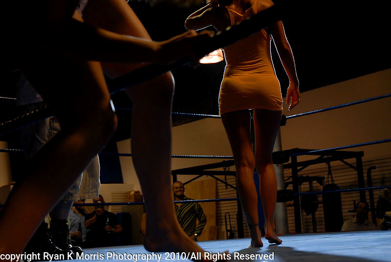 """Invited guests attend a """"catfighting"""" match at a Naples, FL boxing gym. The event, held on the eve of Easter, had celebrity porn star Ron Jeremy as MC. The closed event advertised on Craigslist looking for women to be part of a catfighting DVD production shoot with a live audience. This selection of images is part of a larger project documenting the increased acceptance of pornography and the everyday entertainment habits of Americans..Photos by Ryan K. Morris Photography"""