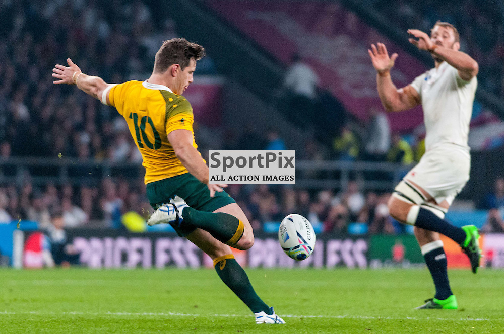 Bernard Foley of Australia kicks the ball down field. Action from the England v Australia game in Pool A of the 2015 Rugby World Cup at Twickenham in London, 3 October 2015. (c) Paul J Roberts / Sportpix.org.uk