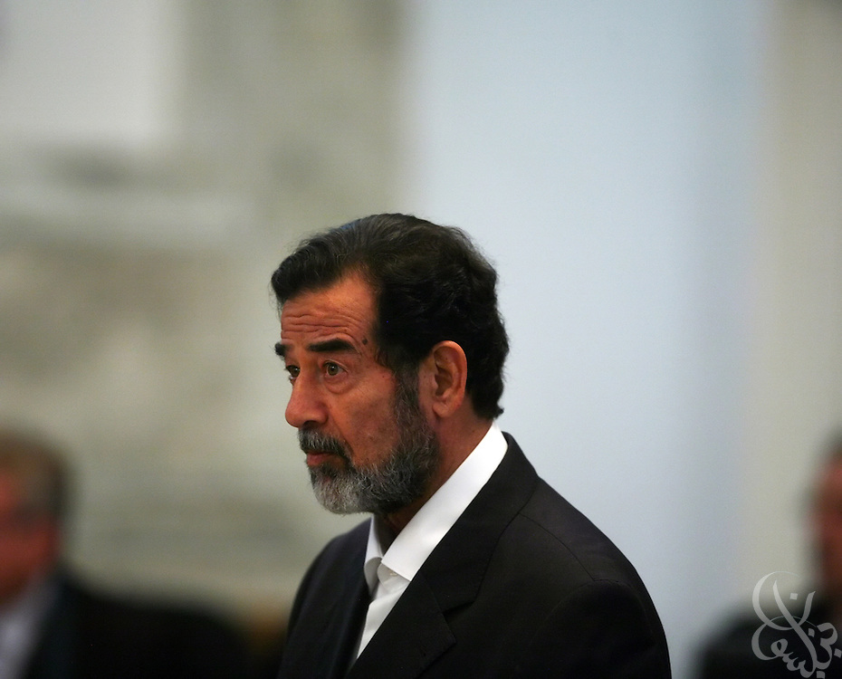 Former Iraqi leader Saddam Hussein listens to the judge during his trial in the heavily fortified Green Zone November 7, 2006. Hussein was sentenced to death and executed by the Iraqi government in December 2006. (Photo by Scott Nelson/World Picture Network)
