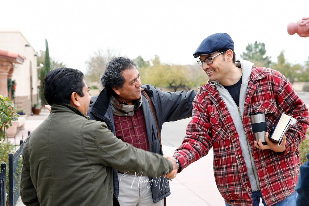 "Julio Inclan (right) greets Jose Zamora (center) and Faustino Santiago at St. Anne Roman Catholic Church in Gilbert, Arizona, Jan. 15, 2017. Men of the parish have been meeting in two groups -- English and Spanish speaking -- to reflect on Bishop Thomas J. Olmsted's ""Into the Breach,"" his 2015 exhortation to Catholic men of the Diocese of Phoenix. (Photo by Nancy Wiechec)"