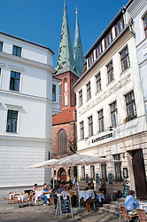 Cafe and old buildings with  Nikolaikirche church in historic Nikolaiviertel district of berlin 2009