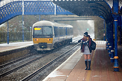 © Licensed to London News Pictures. 13/01/2017. STOKE MANDEVILLE, UK.  A Children Railways train arriving at Stoke Mandeville station in Buckinghamshire during a snow flurry. The UK has been hit by the first cold snap of 2017 with significant snow falling across parts of the country. .  Photo credit: Cliff Hide/LNP