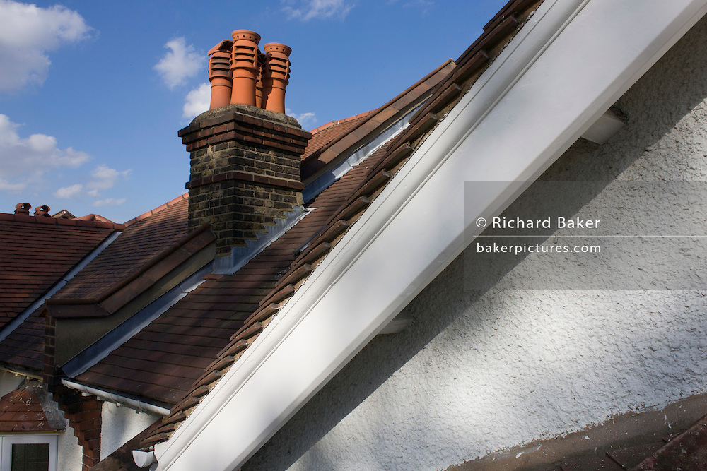 Rooftop view of a suburban Edwardian semi-detached house in south London.