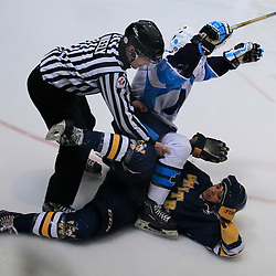 Toronto, ON - Jan 10 : Ontario Junior Hockey League Game Action between Whitby Fury Hockey Club & St.Michael's Buzzer's Hockey Club. Linesman Aaron Neely brakes up players.<br /> (Photo by Mike Ivall / OJHL Images)