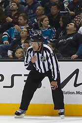 Jan 31, 2012; San Jose, CA, USA; NHL linesman Pierre Champoux (67) before a face off between the San Jose Sharks and the Columbus Blue Jackets during the first period at HP Pavilion. San Jose defeated Columbus 6-0. Mandatory Credit: Jason O. Watson-US PRESSWIRE