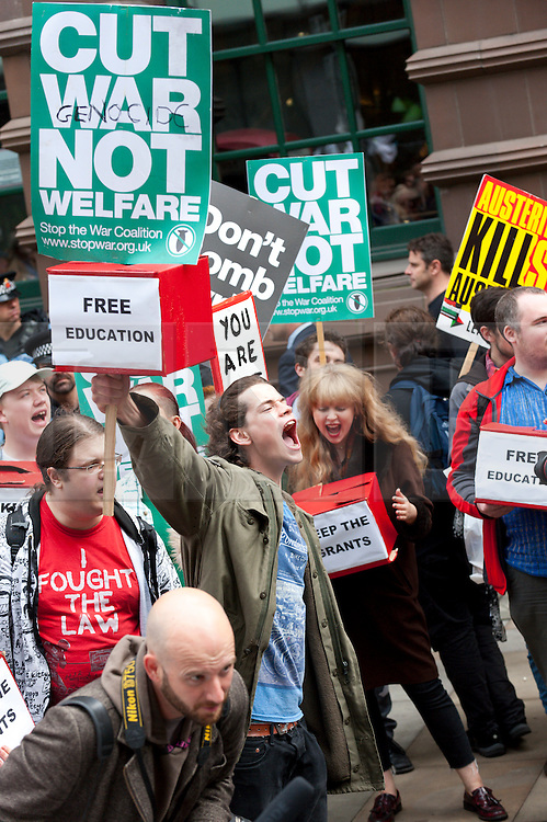 © Licensed to London News Pictures. 05/10/2015. Manchester, UK. Students stage a protest against cuts at the Tory Conference venue. A week of pro-peace, anti-austerity, anti-war, anti-Tory, protests dubbed 'Take Back Manchester' has been  organised by The People's Assembly and timed to coincide with the Conservative Party Conference in Manchester on 4th - 7th Oct 2015. Over 40 events are planned, including a speech by new Labour leader Jeremy Corbyn timed to compete with closing speech of Tory leader David Cameron. Photo credit: Graham M. Lawrence/LNP