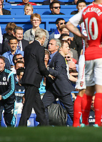 Football - 2014 / 2015 Premier League - Chelsea vs. Arsenal<br /> <br /> José Mourinho, Manager, of Chelsea FC and Arsene Wenger,Manager, of Arsenal FC getting physical at Stamford Bridge<br /> <br /> Colorsport/Daniel Bearham