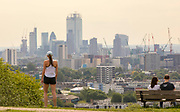 UNITED KINGDOM, London: 22 May 2019 <br /> A jogger stops to take a look over the London skyline as she makes her way over Parliament Hill in Hampstead Heath today. The warm weather is set to continue reaching up to temperatures of 22 C in the capital tomorrow.<br /> Rick Findler / Story Picture Agency
