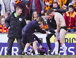Reading's Alex Pearce replaces his blood-stained kit and cleans blood off his face before continuing - Photo mandatory by-line: Matt McNulty/JMP - Mobile: 07966 386802 - 07/03/2015 - SPORT - Football - Bradford - Valley Parade - Bradford City vReading - FA Cup - Quarter Final
