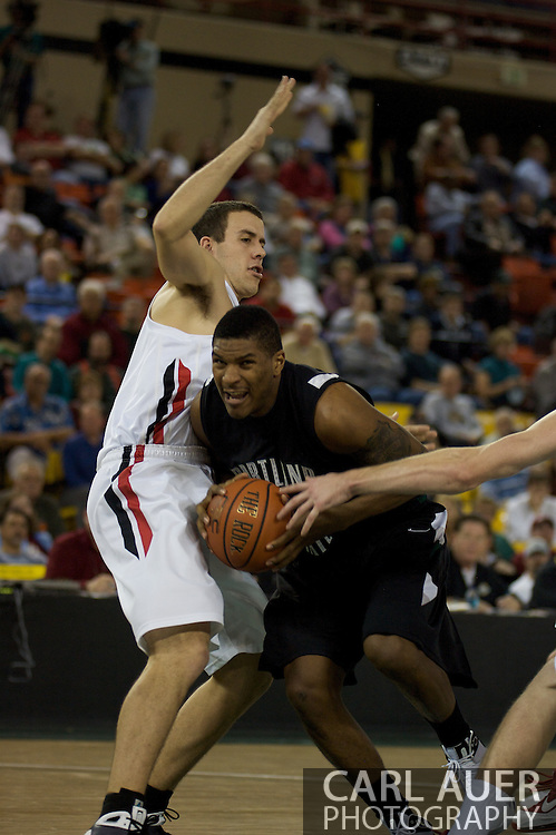November 29th, 2008:  Anchorage, Alaska - Portland State's Julius Thomas (1) drives into Seattle University's Austen Powers in the third place game on the final day of the Great Alaska Shootout.