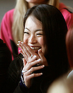 Kaoruko Horiike of Tokyo, Japan smiles as she hears that she is a new Denver Broncos cheerleader after the finals in Denver, Colorado April 1, 2007.  Over 250 women applied for the 34 slots with Horiike being one of them.  REUTERS/Rick Wilking (UNITED STATES)