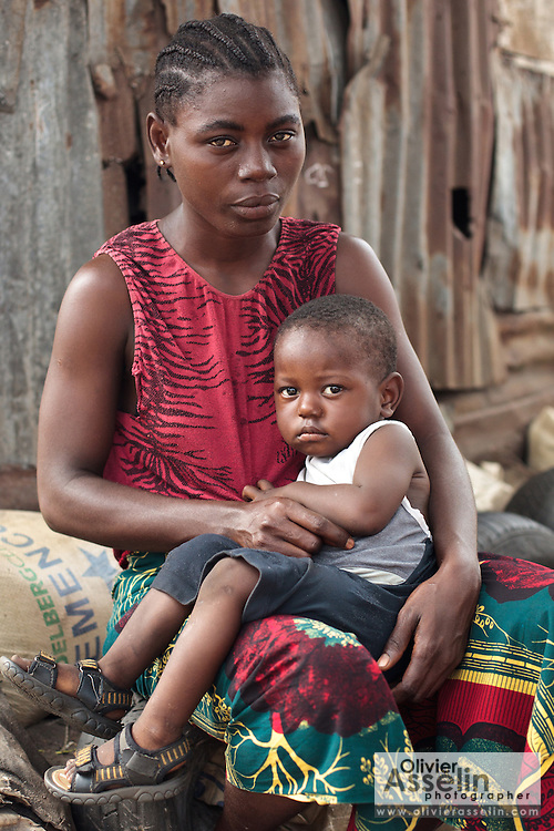 A young boy sits on his mother's lap in the Point Four neighborhood of Monrovia, Montserrado county, Liberia on Thursday April 5, 2012.