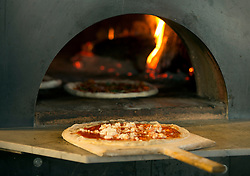 A pizza sits ready to go into the wood-fired oven at The Forge restaurant at Jack London Square, Wednesday, April 24, 2013 in Oakland, Calif. (Photo by D. Ross Cameron)