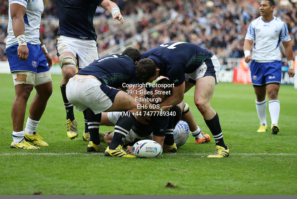 Greig Laidlaw - Scotland captain crashes over the line for the match winning try, flanked by John Hardie (L) and Matt Scott (R) late in the game to take Scotland into the quarter finals of the Rugby World Cup.<br />Scotland v Samoa, Rugby World Cup, Pool B, St James' Park, Newcastle, England, Saturday 10 October 2015<br />***PLEASE CREDIT: FOTOSPORT/DAVID GIBSON***<br /><br /><br />Scotland v Samoa, Rugby World Cup, Pool B, St James' Park, Newcastle, England, Saturday 10 October 2015<br />***PLEASE CREDIT: FOTOSPORT/DAVID GIBSON***
