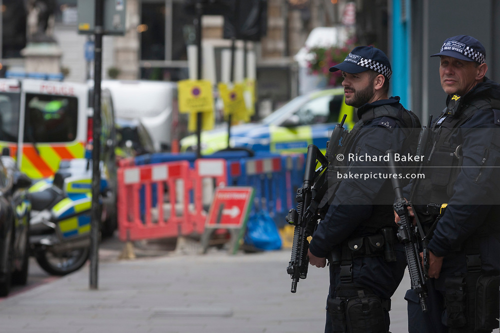 In the aftermath of the London Bridge and Borough Market terrorist attack the previous night, armed police are positioned at closed road junctions a half a mile from the crime scene where 7 people were killed and many others injured (Sunday's total). On Sunday 4th June 2017, in the south London borough of Southwark, England.