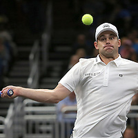 Tennis pro Andy Roddick keeps his eye on the ball as he plays during the PowerShares Tennis Series event at the Amway Center on January 5, 2017 in Orlando, Florida. (Alex Menendez via AP)