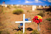 12 JULY 2012 - WINDOW ROCK, AZ: A grave in the Navajo Veterans' Cemetery. More than 300 Navajo veterans are buried in the Veterans' Memorial Cemetery north of Window Rock, AZ, on BIA Highway 12. The cemetery is in the windswept high desert. Members of the military killed overseas are returned to the reservation for burial. The tribe has set aside 10 acres in Chinle, in the center of the reservation, but that site is awaiting funding from Washington.       PHOTO BY JACK KURTZ