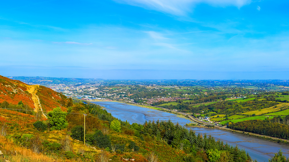 View from Flagstaff Viewpoint looking back towards Newry, showing the Newry River as it makes its way out to Carlingford Lough, with some lovely rich autumnal colours in the foreground.